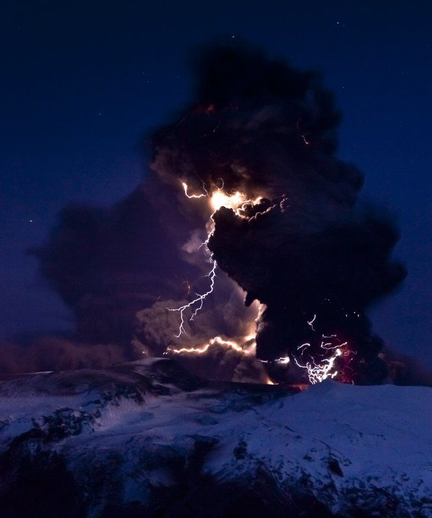 Lightning branches out from behind a veil of ash clouds at Iceland's Eyjafjallajökull volcano in April 2010
