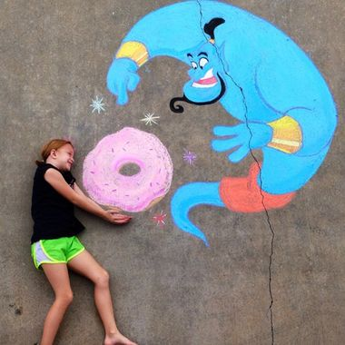 Isn't this sidewalk chalk art of the genie from 'Aladdin' and Homer Simpson's donut amazing? Great for fans of Disney and The Simpsons alike!