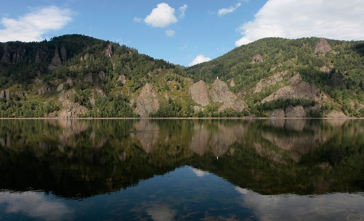 Hills, reflected in the waters of the Yenisei River in the Siberian Taiga district outside Krasnoyarsk, on August 28, 2012. (Reuters/Ilya Naymushin)