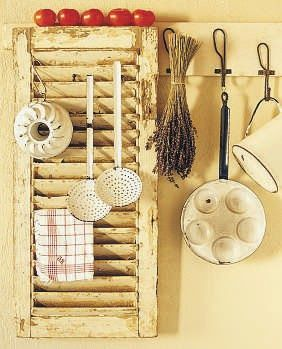 shutter repurposed for kitchen storage and display