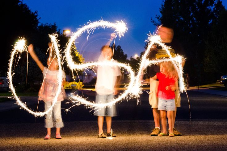 love this idea for sparklers on the Fourth of July (using slow shutter speed on your camera)