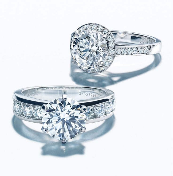 New Tiffany Harmony engagement ring with bead set border and matching band ring in platinum