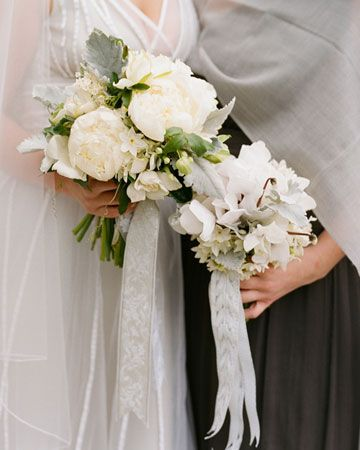 peonies, paperwhites, gardenias, lily-of-the-valley, dusty miller, and passion vine for the bridal bouquet. She tied it off with silver ribbon