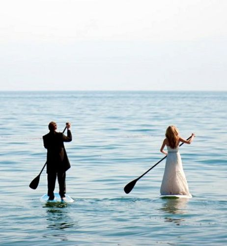Absolutely love this paddle boarding picture of the bride and groom! www.executiveretreats.com.au