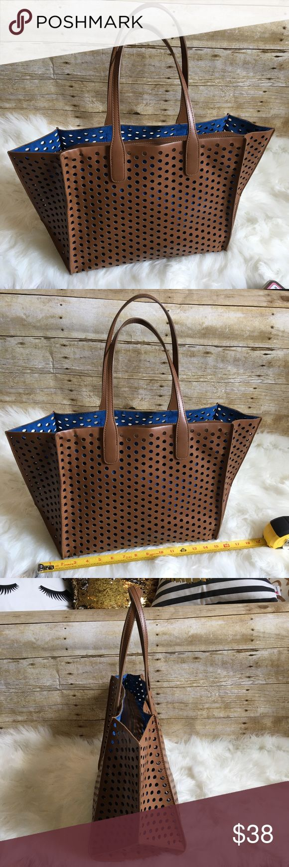 """Zara Geometric tote bag Zara tote bag in good used condition - the inner blue zipper bag is removable. Only flaws I can see is the lifting off the lining on the side and a smaller one on the back (see pics) - This is a good size bag on the larger side. Measures 19"""" x 12""""h x 7.5"""" Zara Bags Totes"""