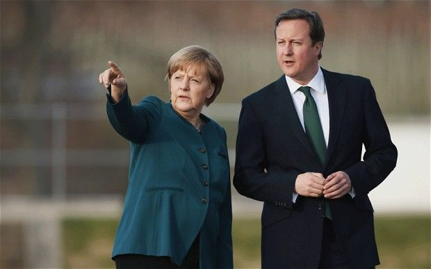 Wealth tax to pay for EU bail-outs--German chancellor Angela Merkel, left, talks with Britain's Prime Minister David Cameron, right, in Meseberg palace near Berlin.