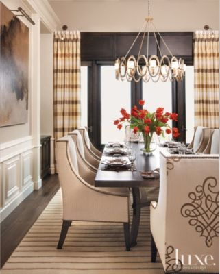 Custom chairs surround a walnut dining table in a San Diego #colonial's #diningroom. See more at www.luxesource.com. #luxe #luxemag #luxury #design #interiordesign #interiors #home #house #dwelling #residential #decor #homedecor #interiordecorating #interiordesignideas #architecture