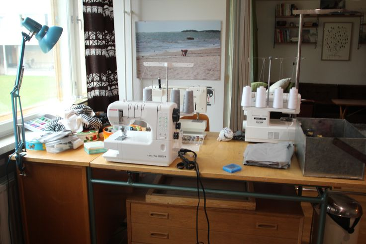 Sewing desk with machines on both sides.