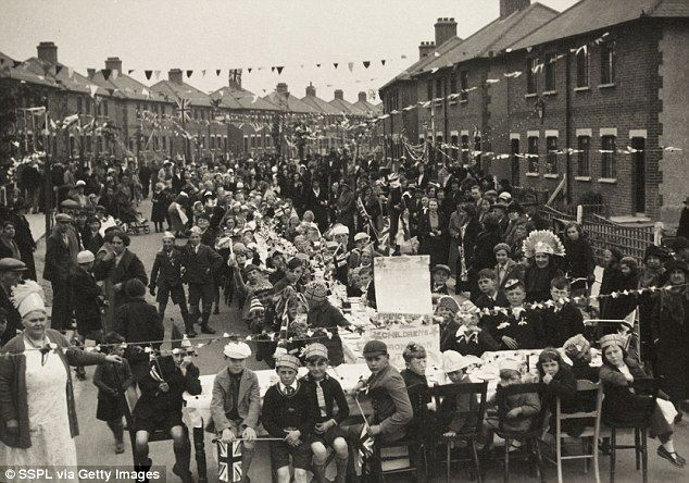 Bunting fluttered across the street in Grays, Thurrock, Essex, at a party for George VI's ...