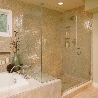 Remove the vanity between the tub and shower to make a larger walk in shower with sitting ledge