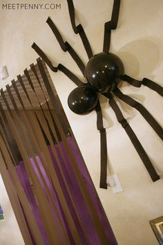 Check out these Minecraft party decorations! Make a Minecraft spider from black balloons and crepe streamers. A portal is made from purple and black crepe streamers. EASY! She includes Minecraft party printables and has great ideas for Minecraft party decorations, games, and more!