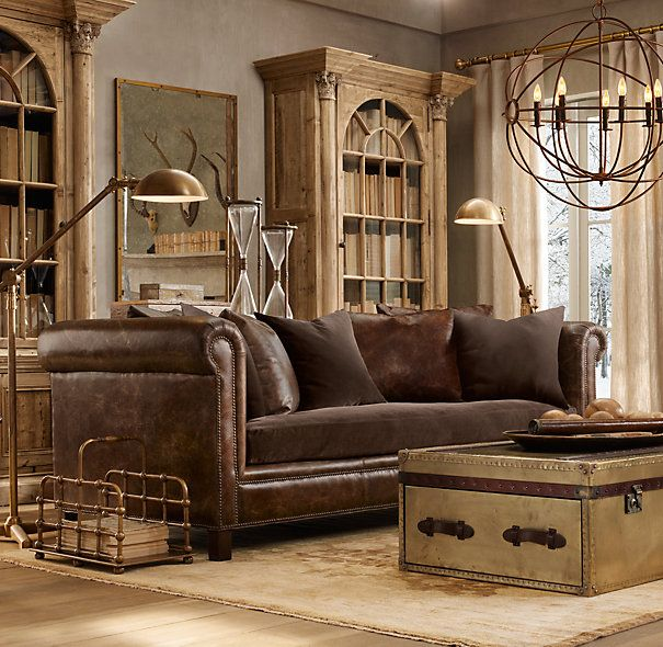 Restoration Hardware living room ...looks like ours...leather sofa, trunk, rug, but no chandelier hmmm