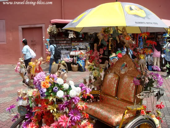 In order to attract the customers, rickshaws were decorated with any colourful things that the riders could think of. It includes Barbie dolls. BARBIE DOLLS! Could you spot them in the picture? So adorable! (Melaka, Malaysia)