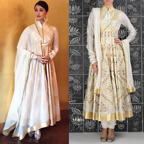 The stunning Aishwarya Rai exudes ethnic chic in a Rohit Bal laser cut ivory anarkali suit with appliqué work.