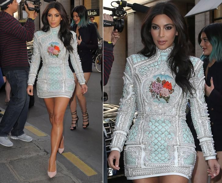 Leave it to Kim Kardashian to make a fashion statement! While the reality TV star has been getting plenty of attention from fans and paparazzi in Paris, Kim K only attracted more when she arrived at Costes in a heavily beaded dress complete with tapestry on May 22, 2014. The Kardashian-Jenner clan flocked to the City of Love for Kim and Kanye's rumored wedding.