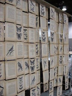 Vintage Show Off: Creative Booth Wall from Book Pages