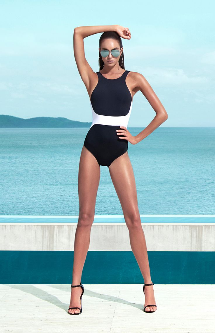 Jets by Jessika Allen Classique High Neck One Piece || A modern athletic one piece that's anything but basic, this suit features contrasting panels that narrow at the waist and a high neckline which lengthens the look of the torso. Best Suited for: A-C cup.