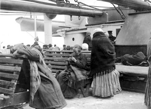 This picture, taken by Father Frank Browne, depicts steerage passengers getting settled on their Titanic deck.