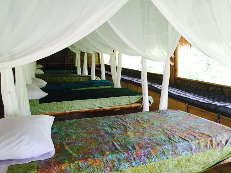 Swinging beds with batik bed covers in the Bamboo Lodge at Captain Coconuts Gili Air