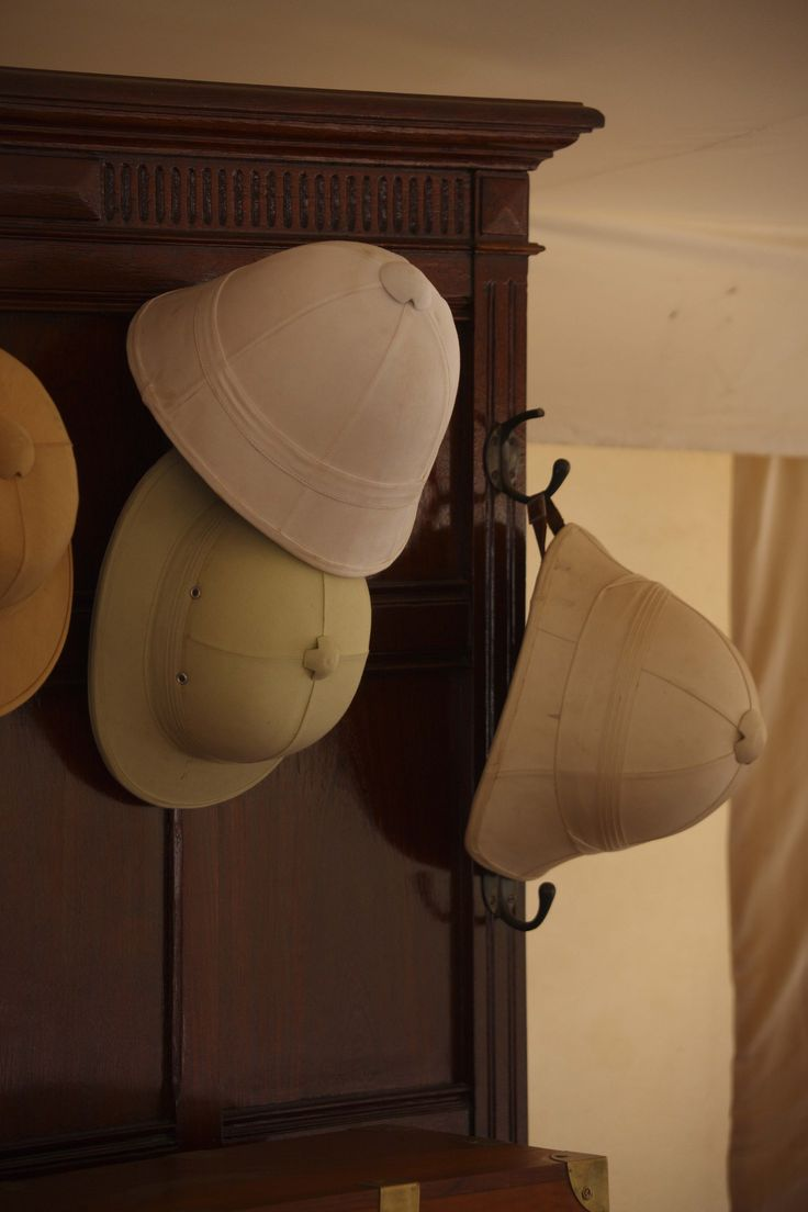 Hats-like ours in the back hall