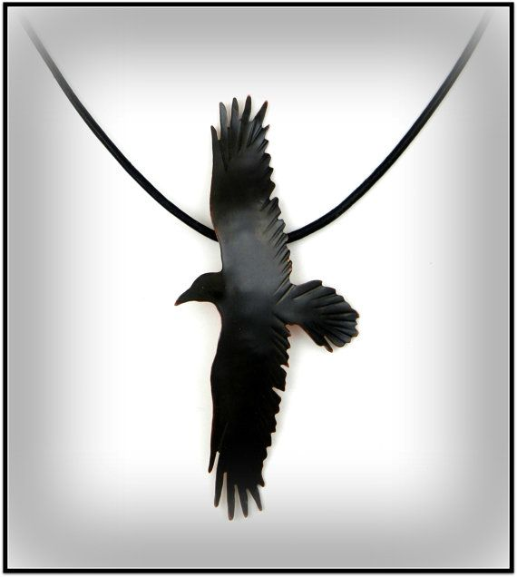 This awesome crow necklace is hand cut and tooled from copper sheet and depicts a crow in flight.  My Process: I use a pierce and cut technique, making a series of inside and outside cuts with a tiny handheld jewelry saw to create the design. A patina is then added to the copper rendering it black to showcase the natural color of the crow. There is great attention paid to detailing the feathers in this piece as shown in the closeup image. A gloss finish has been applied to keep this piece…