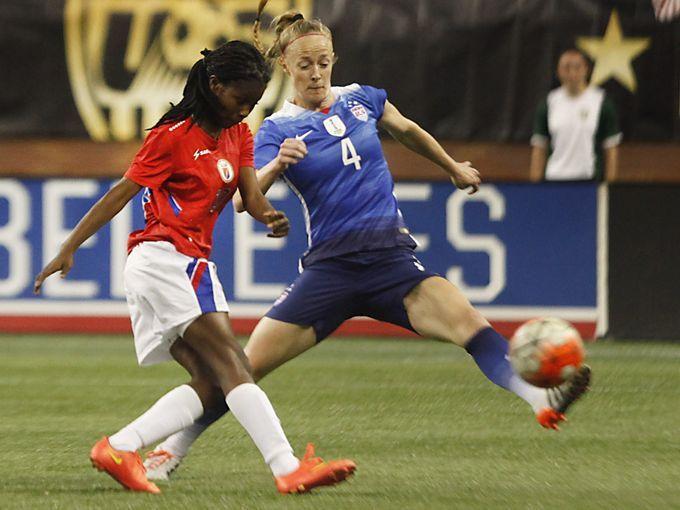 Becky Sauerbrunn and Betcheba Louis of Haiti, Sept. 17, 2015. (Diane Weiss/Detroit Free Press)
