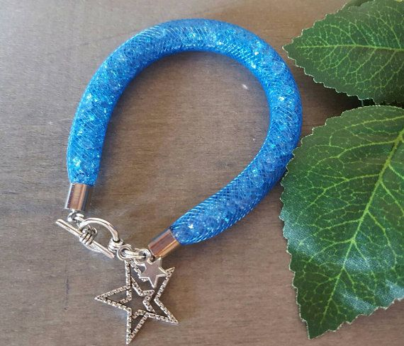Handmade mesh tube bracelet with acrylic crystals and charms.  Pictured bracelet suits wrist size up to 16cms Suits ages 6-9   Please email on craftypapilio@gmail.com for any further information Every bracelet will be packaged individually in an organza bag.
