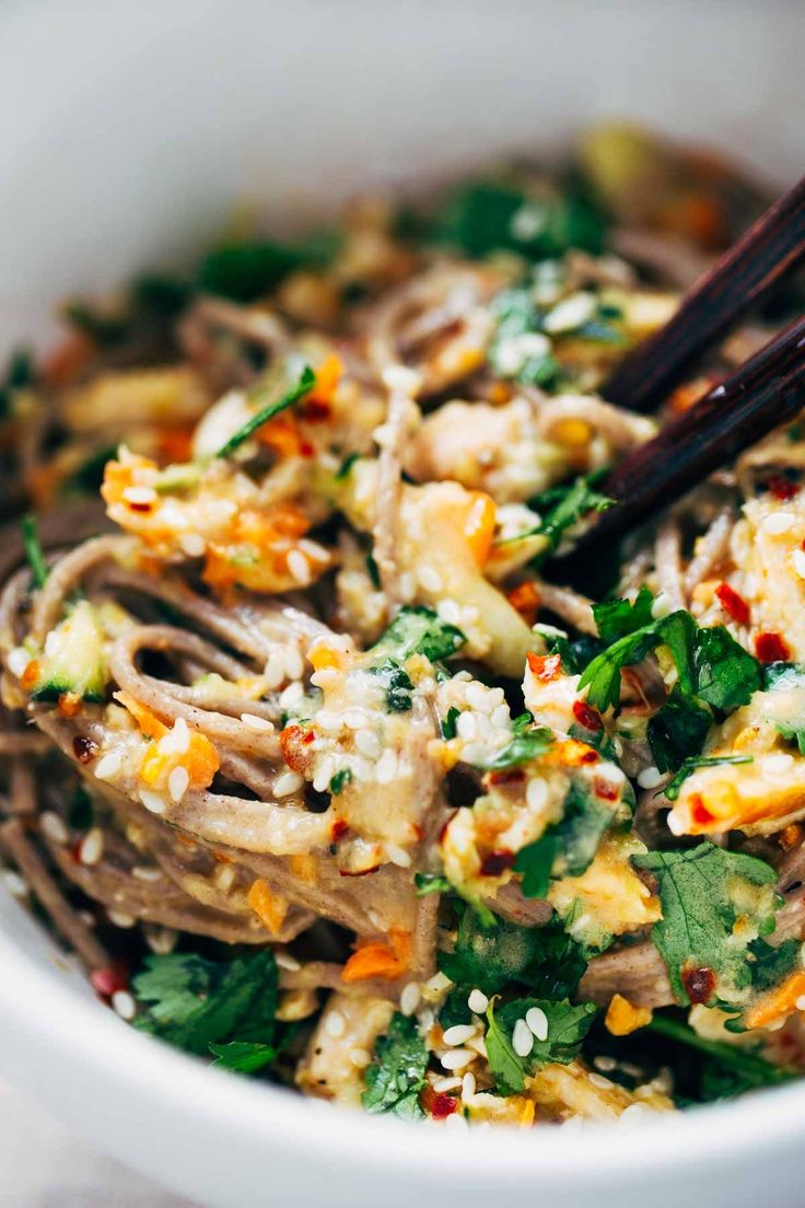 Chopped Chicken Sesame Noodle Bowls - loaded with veggies, chicken, cilantro, and a homemade sesame-peanut sauce. So good! 325 calories.