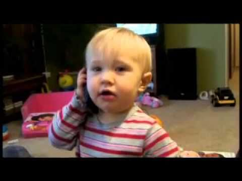 added to board for comic relief: Pleasant Phone Demeanor | OrangeCabinet  |  Tot girl grabs a cell phone burps and drools.
