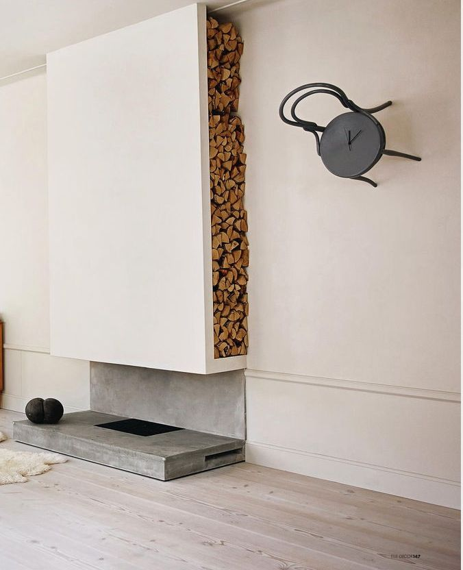 Vertical built-in firewood shelving (don't much care for the rest of the design, but the wood storage is definitely cool)