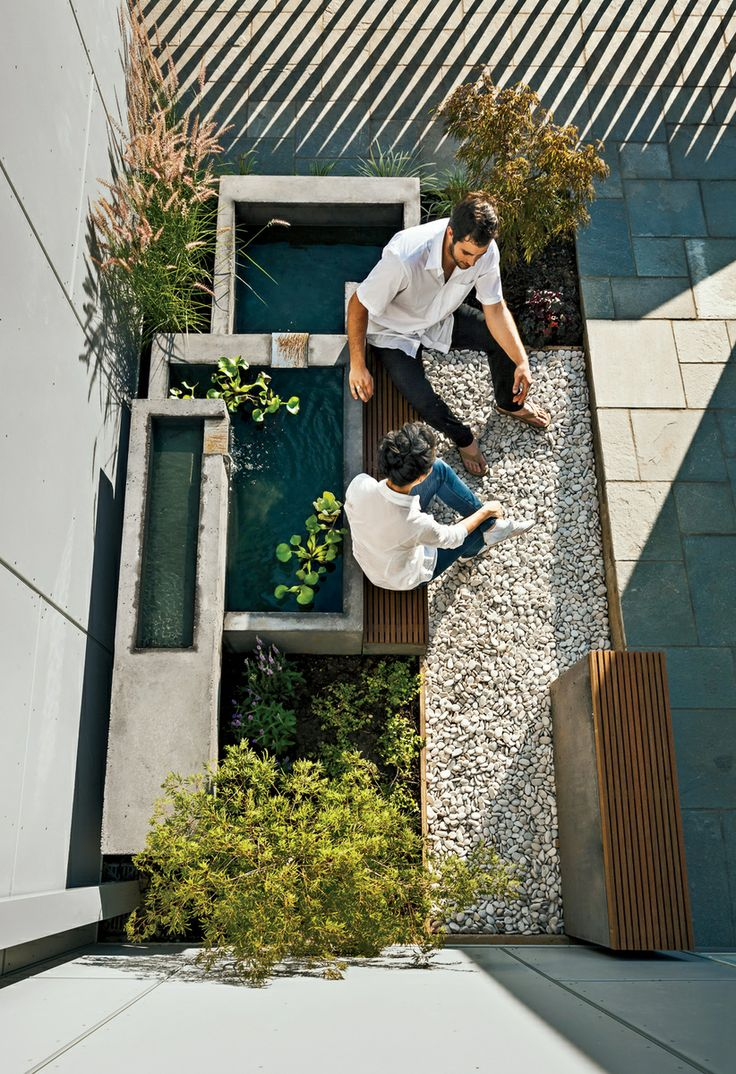 SECRET GARDEN In Arlington, Virginia, by architecture firm Höweler + Yoon contending with spatial and budgetary constraints to carve a microcourtyard, complete with Japanese maples and a cascading concrete fountain, in just 200 square feet.