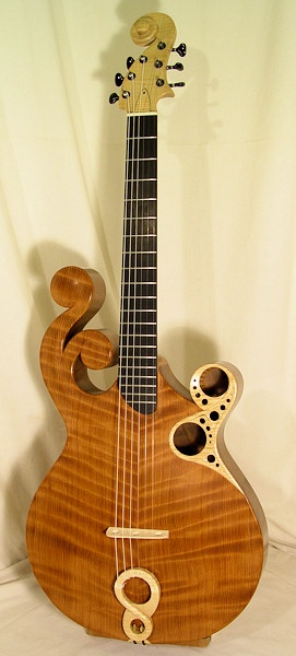 Prohaszka. Check out the gorgeous scroll-work and nonlinear tuning pegs!