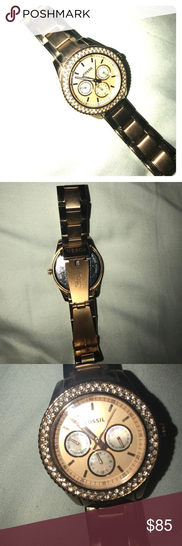 Rose Gold Fossil watch Gorgeous rose gold watch with rhinestones around the face! Comes in original fossil tin box which is also very cute! In great condition, just needs a battery 😊 there is one rhinestone missing, hard to tell at all! Fossil Accessories Watches