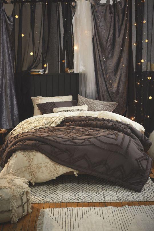 Cozy dark bedroom | shop the look: cream duvet cover - dark comforter - stripe rug - textured rug - sequin pillow - cream sham set - dark tufted sham set - velvet pillow - moroccan pouf - string lights Follow Gravity Home: Blog - Instagram -...