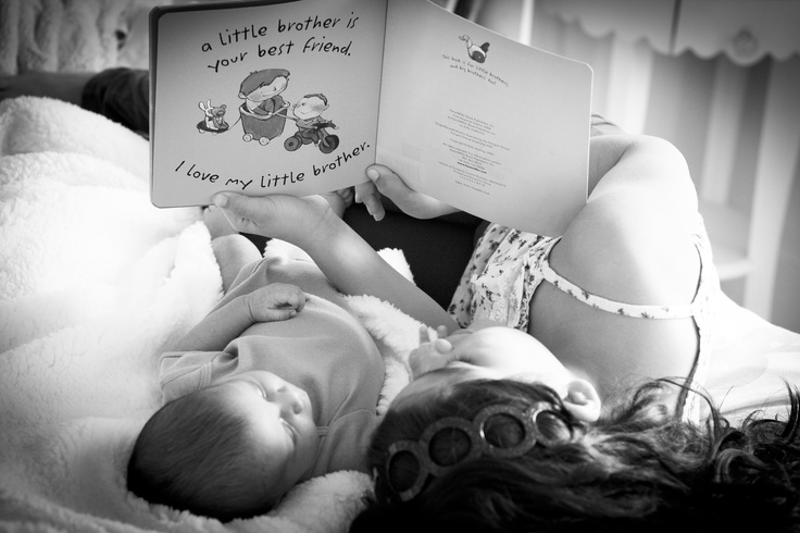 My daughter and her little brother.  She was reading him this book and I made a mad dash for the camera.