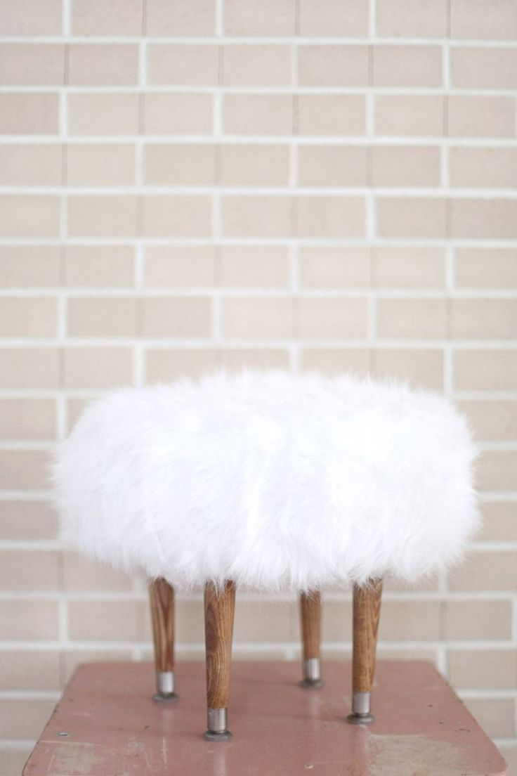 How to make a faux fur foot stool: http://www.abeautifulmess.com/2013/12/make-your-own-faux-fur-footstool.html