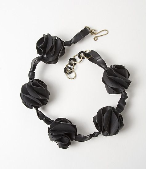 Millie Necklace by Kathleen Nowak Tucci. Recycled rubber necklace made with used bicycle inner tubes. Pieces are hand-cut and artist assembled. A thorough washing process rids them of