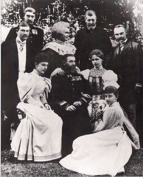 King Carol I with consort  Elisabeth aka Carmen Sylva surrounded by duchess Charlotte of Saxe Meiningen (left) her daughter, Pss Feodora of Saxe Meiningen (sitting on the ground), Crownprincess Marie (Right), his nephew Wilhelm of Hohenzollern Sigmaringen(left), Crownprince Ferdinand, Leopold of Hohenzollern-Sigmaringen and  duke Bernhard of Saxe Meiningen. Mids 1890s