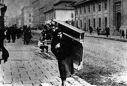 The Kazimierz district, Krakowska Street. March 1941. Jews being taken to the ghetto in Podgorze district.