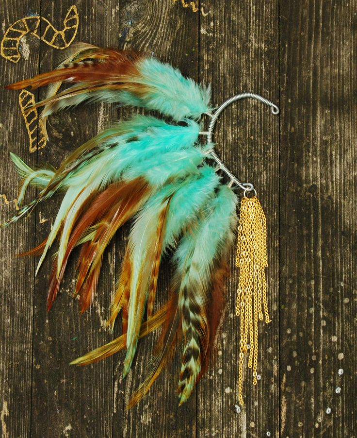 Feather Ear Cuff - Gold Moon. $28.00, via Etsy.