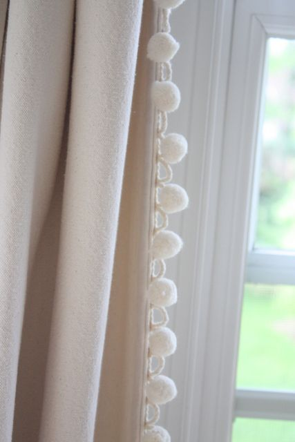 sewing ball fringe on plain canvas curtains!  Maybe this is what I need to do in our bedroom! FINALLY an idea I like!