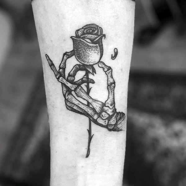 Skeleton Hand Holding Flower 75 skeleton hand tattoo designs for men ...