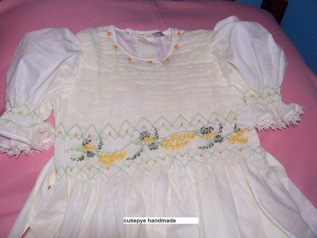 smocked flower girl gown with hand embroidered wattle flowers in ribbon and cotton inspired by the Australian bush native creation in ivory muslin by cutiepye 0427820744 0427820744