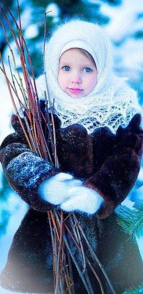 Blue-eyed girl in Russian Orenburg shawl. http://www.therussianstore.com/Russian-Shawls-Pavlovo-Posad.html