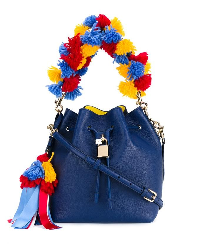 This blue Dolce & Gabbana pom-pom leather bucket bag is a quirky piece from the brand's vintage-inspired SS '16 ready-to-wear collection. A fine example of the brand's Italian craftsmanship and technical expertise, this leather bag has been designed with a bucket shape and features a drawstring closure and a detachable shoulder strap. The detachable top handle has been punctuated with multi-coloured wool pompoms which have also been fashioned into a charm with multiple ribbons. Wear yours…