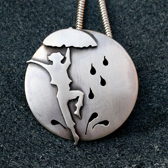 Sterling silver pendant Dancing in the Rain. Handmade for you.    Dance through the puddles, take the rainy days in your stride.    Handmade