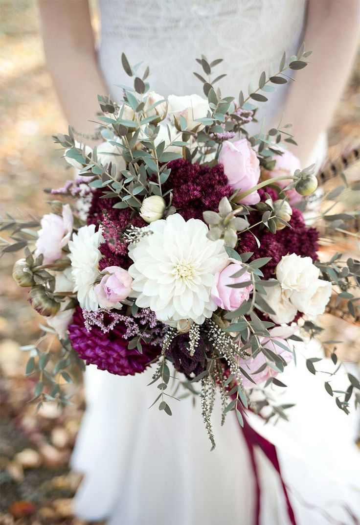 Beautiful bridal bouquet in berry colors or b …