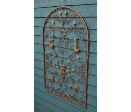 The blank wall needs something that resembles a window e.g. this Arch Metal Wall Art by Gardman