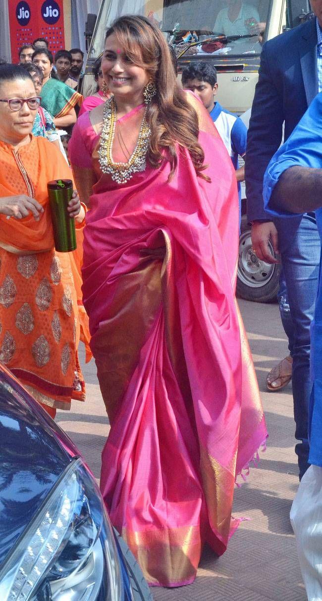 Rani Mukerji celebrating Durga Puja in a pink silk sari