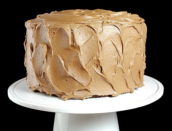 I wanna make this cake and bury my face in it. Three layers chocolate cake with caramel-milk chocolate frosting.